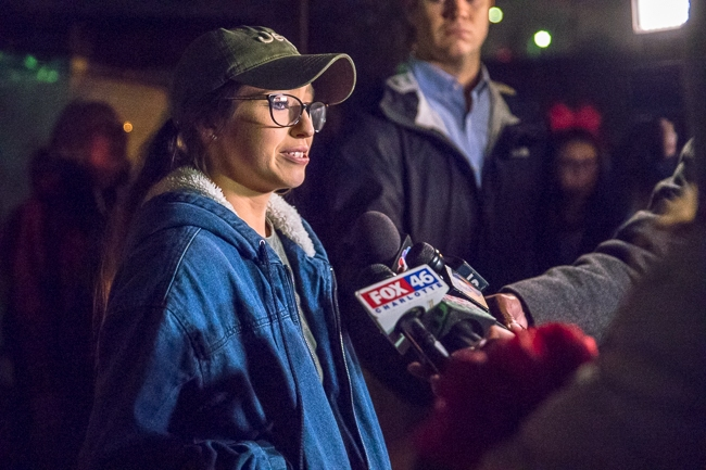 Lauren Brooks, niece of Scott Brooks, speaks to media at a candlelight service held at Brooks' Sandwich House in honor of Scott.