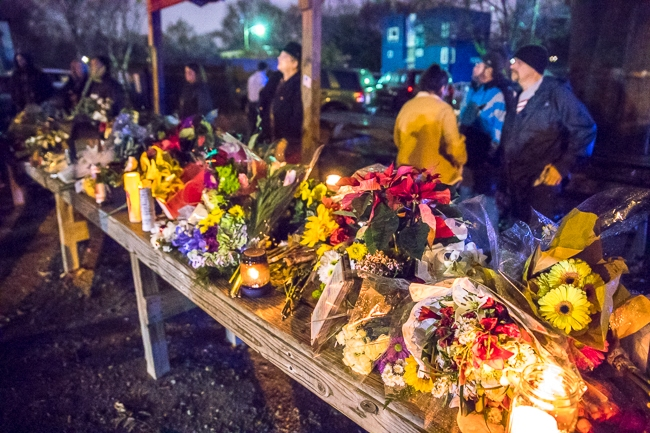 Wreaths, flowers, and notes were left by the community at Brooks' Sandwich House, where Scott Brooks was killed earlier this week.