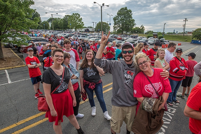 Crowds wait patiently to enter Bojangles Coliseum for the Charlotte Checkers free fan event celebrating their win at the 2019 Calder Cup Championship.