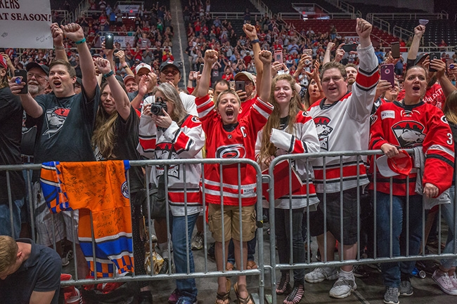 Charlotte Checkers players and coaches hi-five fans as they enter Bojangles Coliseum to celebrate winning the 2019 Calder Cup Championship.