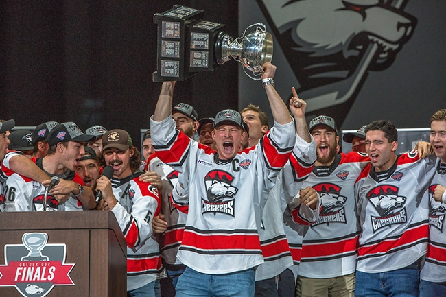 Charlotte Checkers Forward Patrick Brown holds the Calder Cup as the team celebrates with their fans at Bojangles Coliseum.