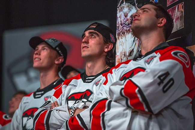 Charlotte Checkers players watch a highlight reel of the teams 2019 Calder Cup Championship win.