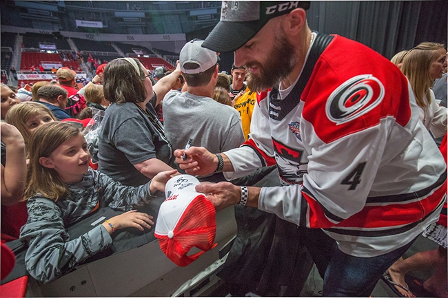 Charlotte Checkers players meet fans and sign autographs at Bojangles Coliseum during a special event celebrating the team winning the 2019 Calder Cup Championship.