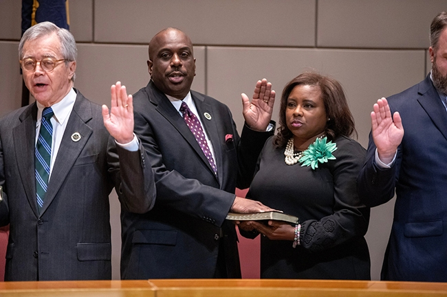 Councilman Malcolm Graham is sworn in.