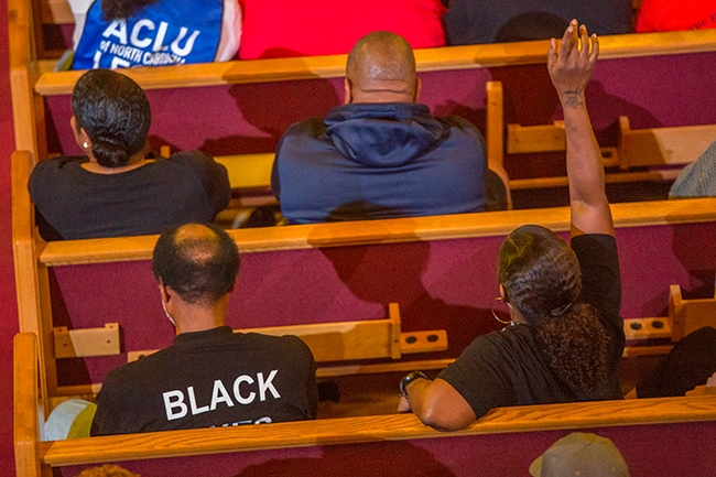 Concerned community members ask CMPD Chief Kerr Putney questions at Friendship Missionary Baptist Church during an event held in response to the shooting of Danquirs Franklin during an altercation with police earlier in the week.