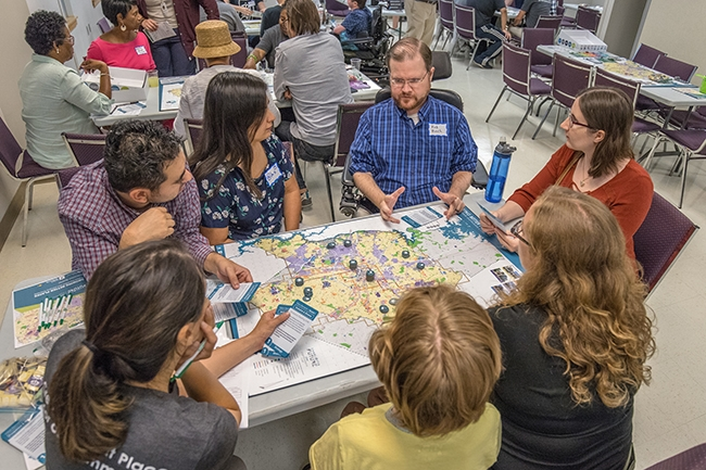 "Participants play the ""Growing Better Places: A More Equitable and Inclusive Charlotte"" board game at Potions & Pixels Gaming For Charlotte event at The Park Church on Beatties Ford Road."