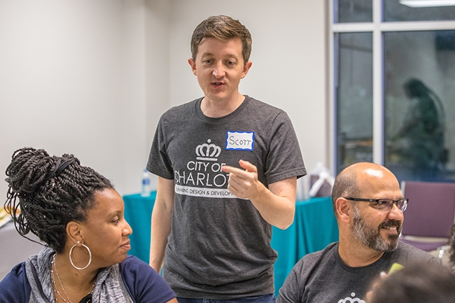 Scott Correll, Senior Principal Planner at City Of Charlotte, helps lead the Potions & Pixels Gaming For Charlotte event at The Park Church on Beatties Ford Road.
