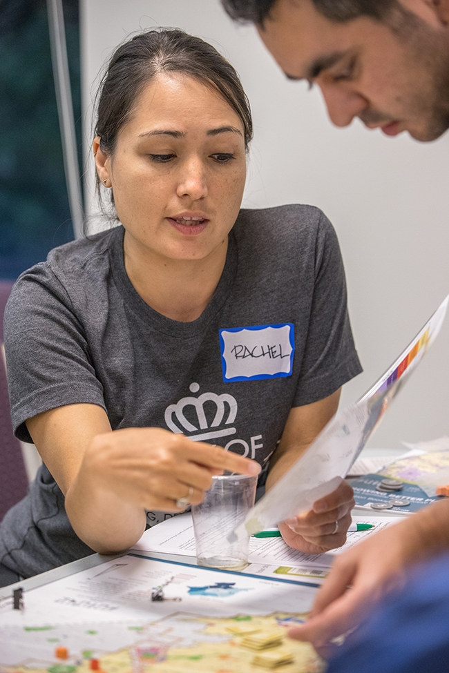 """Participants play the """"Growing Better Places: A More Equitable and Inclusive Charlotte"""" board game at Potions & Pixels Gaming For Charlotte event at The Park Church on Beatties Ford Road."""