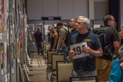 Patrons of the Heroes Convention 2019 art auction, Westin Hotel, look at the items to be auctioned off that evening.