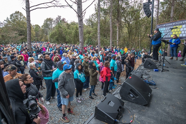 During a prayer walk event, the Love Life group has guest speakers and music on a stage via an adjacent property to the abortion clinic on Latrobe Drive in Charlotte.