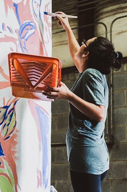 Irisol Gonzalez at a META brush-painting class.