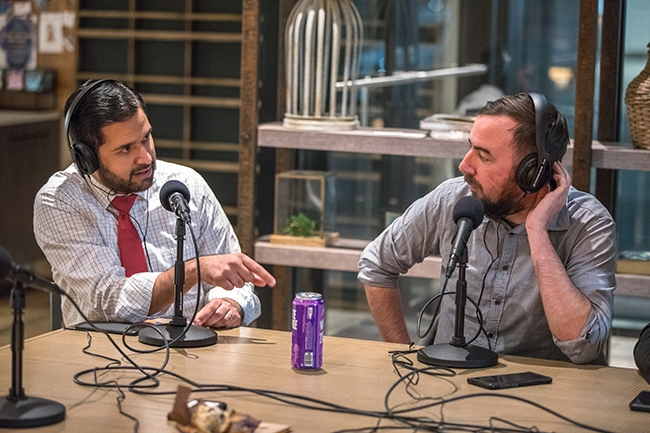 NC Senator Mujtaba Mohammed (left) joins Queen City Nerve for a special on-location recording of Nooze Hounds, at Coco And The Director Coffee & Co-Lab.