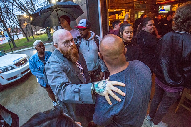 Andrew Woods, Former Pizza Peel Employee, recieves support from fellow protesters during a brief sit-in at the Plaza Midwood Pizza Peel location. Woods made demands about changes he wants made in how the company deals with black and LGBTQ employees.